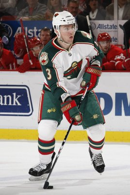 DETROIT - MARCH 11:  Marek Zidlicky #3 of the Minnesota Wild plays the puck against the Detroit Red Wings during their NHL game on March 11, 2010 at Joe Louis Arena in Detroit, Michigan. (Photo by Gregory Shamus/Getty Images)