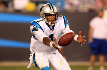 CHARLOTTE, NC - AUGUST 13:  Cam Newton #1 of the Carolina Panthers tries to regain control of a bad snap during their preseason game against the New York Giants at Bank of America Stadium on August 13, 2011 in Charlotte, North Carolina.  (Photo by Streete