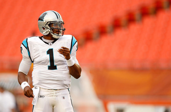 MIAMI GARDENS, FL - AUGUST 19:  Cam Newton #1 of the Carolina Panthers warms up before an NFL preseason game against the Miami Dolphins at Sun Life Stadium on August 19, 2011 in Miami Gardens, Florida.  (Photo by Mike Ehrmann/Getty Images)