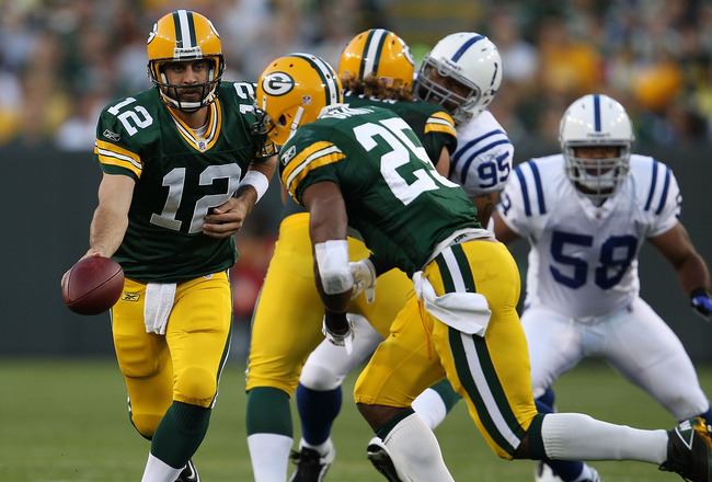 GREEN BAY, WI - AUGUST 26: Aaron Rodgers #12 of the Green Bay Packers turns to hand off to Ryan Grant #25 against the Indianapolis Colts during a preseason game at Lambeau Field on August 26, 2010 in Green Bay, Wisconsin. The Packers defeated the Colts 59