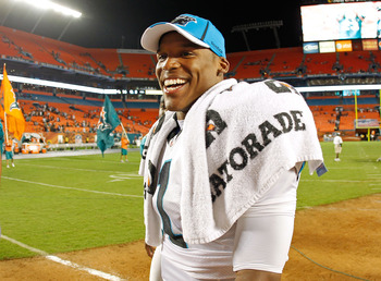 MIAMI GARDENS, FL - AUGUST 19:  Cam Newton #1 of the Carolina Panthers walks off the field after a Preseason NFL game against the Miami Dolphins at Sun Life Stadium on August 19, 2011 in Miami Gardens, Florida.  (Photo by Mike Ehrmann/Getty Images)