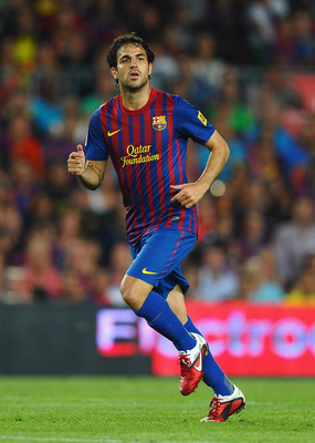 BARCELONA, SPAIN - AUGUST 17: Cesc Fabregas of Barcelona in action during the Super Cup second leg match between Barcelona and Real Madrid at Nou Camp on August 17, 2011 in Barcelona, Spain.  (Photo by Laurence Griffiths/Getty Images)