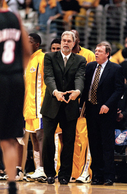 LOS ANGELES - JUNE 4:  Head coach Phil Jackson of the Los Angeles Lakers signals triangle defense as assistant coach Frank Hamblen looks on during Game 7 of the Western Conference Finals against the Portland Trail Blazers at Staples Center on June 4, 2000