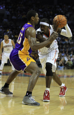 CHARLOTTE, NC - FEBRUARY 14:  Ron Artest #15 of the Los Angeles Lakers defends Gerald Wallace #3 of the Charlotte Bobcats during their game at Time Warner Cable Arena on February 14, 2011 in Charlotte, North Carolina. NOTE TO USER: User expressly acknowle