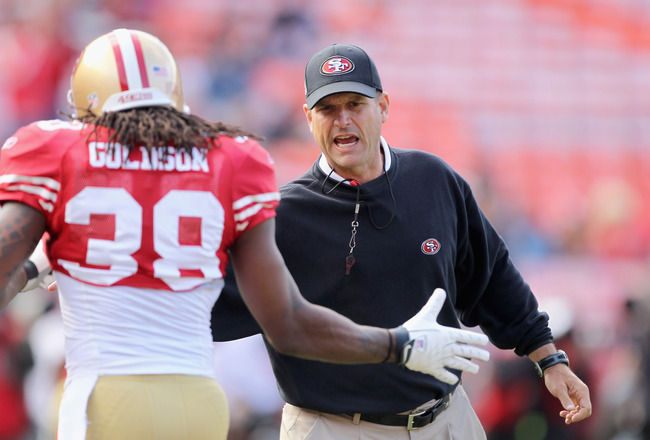 SAN FRANCISCO, CA - AUGUST 20:  Head coach Jim Harbaugh of the San Francisco 49ers shakes hands with Dashon Goldson #38 before their game against the Oakland Raiders at Candlestick Park on August 20, 2011 in San Francisco, California.  (Photo by Ezra Shaw