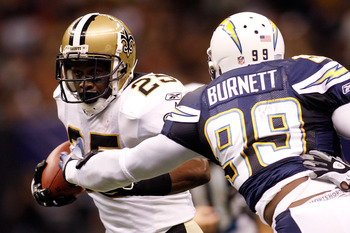 NEW ORLEANS - AUGUST 27:  Reggie Bush # 25 of the New Orleans Saints is tackled by Kevin Burnett #99 of the San Diego Chargers at the Louisiana Superdome on August 27, 2010 in New Orleans, Louisiana.  (Photo by Chris Graythen/Getty Images)