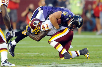 LANDOVER, MD - AUGUST 21:  Kareem Moore #41 of the Washington Redskins makes a tackle during the preseason game against Todd Heap #86 of the Baltimore Ravens at FedExField on August 21, 2010 in Landover, Maryland.  (Photo by Greg Fiume/Getty Images)