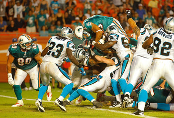 MIAMI GARDENS, FL - AUGUST 19:  Lex Hilliard #26 of the Miami Dolphins scores a touchdown during a Preseason NFL game against the  Carolina Panthers at Sun Life Stadium on August 19, 2011 in Miami Gardens, Florida.  (Photo by Mike Ehrmann/Getty Images)