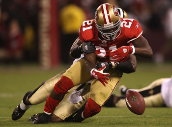 SAN FRANCISCO - SEPTEMBER 20:  Frank Gore #21 of the San Francisco 49ers fumbles the ball against the New Orleans Saints during an NFL game at Candlestick Park on September 20, 2010 in San Francisco, California.  (Photo by Jed Jacobsohn/Getty Images)