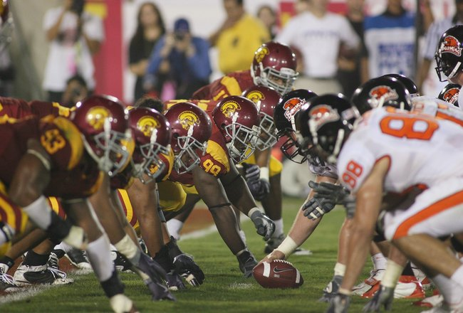 LOS ANGELES, CA - OCTOBER 24:  Averell Spicer #99 of the USC Trojans and the defense line up against the Oregon State Beavers offense on October 24, 2009 at the Los Angeles Coliseum in Los Angeles, California.  USC won 42-36.  (Photo by Jeff Golden/Getty