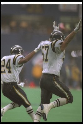 15 Jan 1995:  Linebacker Dennis Gibson of the San Diego Chargers (right) celebrates during a playoff game against the Pittsburgh Steelers at Three Rivers Stadium in Pittsburgh, Pennsylvania.  The Chargers won the game, 17-13. Mandatory Credit: Rick Stewar