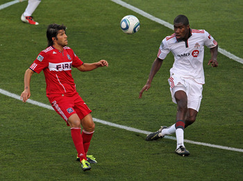 BRIDGEVIEW, IL - AUGUST 21:  Sebastian Grazzini #10 of the Chicago Fire and Andy Iro #3 of Toronto FC move to the ball during an MLS match at Toyota Park on August 21, 2011 in Bridgeview, Illinois.  The Fire defeated Toronto FC 2-0.  (Photo by Jonathan Da