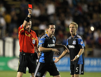 SANTA CLARA, CA - AUGUST 13:  Referee Paul Ward gives Sam Cronin #4 of the San Jose Earthquakes a red card in front of Brad Ring #5 of the San Jose Earthquakes during their game against the Colorado Rapids at Buck Shaw Stadium on August 13, 2011 in Santa