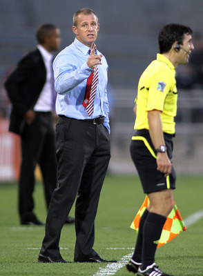 COMMERCE CITY, CO - AUGUST 20: Colorado Rapids coach Gary Smith questions a call by a referee along the sidelines during a game against Chivas USA during their game at Dick's Sporting Goods Park August 20, 2011 in Commerce City, Colorado. (Photo by Marc P