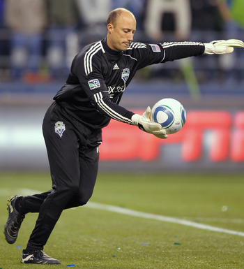 SEATTLE, WA - OCTOBER 31:  Goalkeeper Kasey Keller #18 of the Seattle Sounders FC punts the ball against the Los Angeles Galaxy during the 1st leg playoff game at Qwest Field on October 31, 2010 in Seattle, Washington. (Photo by Otto Greule Jr/Getty Image