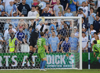KANSAS CITY, KS - AUGUST 06:  Keeper Kasey Keller #18 of the Seattle Sounders FC saves a shot on goal by Sporting Kansas City during the first half on August 6, 2011 at LiveStrong Sporting Park in Kansas City, Kansas.  (Photo by Peter G. Aiken/Getty Image