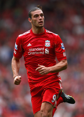 LIVERPOOL, ENGLAND - AUGUST 06:  Andy Carroll of Liverpool in action during the pre season friendly match between Liverpool and Valencia at Anfield on August 6, 2011 in Liverpool, England.  (Photo by Clive Brunskill/Getty Images)