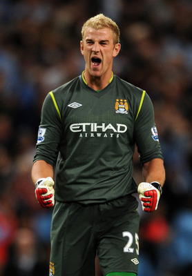 MANCHESTER, ENGLAND - AUGUST 15:  Goalkeeper Joe Hart of Manchester City celebrates his side's opening goal during the Barclays Premier League match between Manchester City and Swansea City at Etihad Stadium  on August 15, 2011 in Manchester, England.  (P