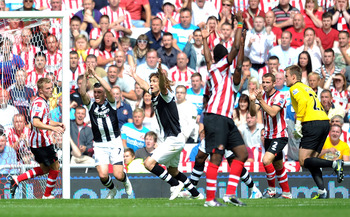 SUNDERLAND, ENGLAND - AUGUST 20:  Joey Barton of Newcastle United and Fabricio Coloccini appeal for handball during the Barclays Premier League match between Sunderland and Newcastle United at Stadium of Light on August 20, 2011 in Sunderland, England.  (