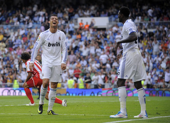 MADRID, SPAIN - MAY 21: Cristiano Ronaldo (L) of Real Madrid celebrates with teammate Emmanuel Adebayor after Adebayor scored Real's second goal during the La Liga match between Real Madrid and UD Almeria at Estadio Santiago Bernabeu on May 21, 2011 in Ma