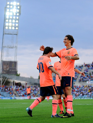 GETAFE, SPAIN - SEPTEMBER 12:  Lionel Messi (L) of Barcelona celebrates scoring his side's second goal with his team mate Zlatan Ibrahimovic during the La Liga match between Getafe and Barcelona at the Coliseum Alfonso Perez stadium on September 12, 2009