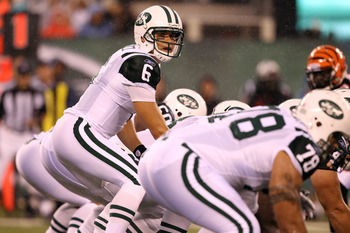 EAST RUTHERFORD, NJ - AUGUST 21:  Mark Sanchez #6 of the New York Jets in action against the Cincinnati Bengals during their pre season game on August 21, 2011 at the New Meadowlands Stadium in East Rutherford, New Jersey.  (Photo by Al Bello/Getty Images