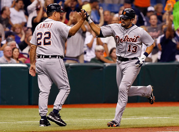 ST. PETERSBURG, FL - AUGUST 24:  Catcher Alex Avila #13 of the Detroit Tigers is congratulated by third base coach Gene Lamont #22 after his home run against the Tampa Bay Rays during the game at Tropicana Field on August 24, 2011 in St. Petersburg, Flori