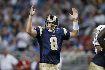 ST. LOUIS, MO - AUGUST 13: Sam Bradford #8 of the St. Louis Rams celebrates a touchdown during the first half of the NFL preseason game against the Indianapolis Colts at Edward Jones Dome on August 13, 2011 in St. Louis, Missouri. (Photo by Joe Robbins/Ge