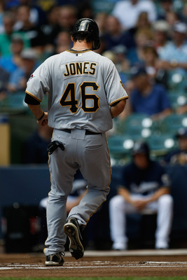 MILWAUKEE, WI - AUGUST 14: Garrett Jones #46 of the Pittsburgh Pirates steps on home plate to score a run against the Milwaukee Brewer at Miller Park on August 14, 2011 in Milwaukee, Wisconsin. (Photo by Scott Boehm/Getty Images)
