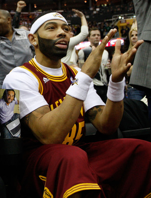 CLEVELAND - MARCH 29: Joe Haden of the Cleveland Browns cheers on the Cleveland Cavaliers during the game against the Miami Heat on March 29, 2011 at Quicken Loans Arena in Cleveland, Ohio. NOTE TO USER: User expressly acknowledges and agrees that, by dow