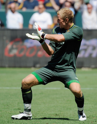 CARSON, CA - JULY 24:  Goalkeeper Joe Hart #25 of Manchester City celebrates after kicking the winning penalty kick to decide a tie game against Los Angeles Galaxy during the Herbalife World Football Challenge 2011 at the Home Depot Center on July 24, 201