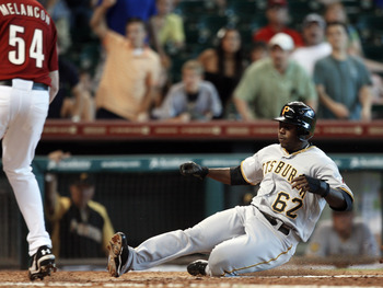 HOUSTON - JULY 17: Josh Harrison #62 of the Pittsburgh Pirates scores on a passed ball in the eleventh inning against the Houston Astros at Minute Maid Park on July 17, 2011 in Houston, Texas. (Photo by Bob Levey/Getty Images)