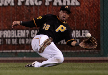 PITTSBURGH - AUGUST 16:  Xavier Paul #38 of the Pittsburgh Pirates makes a diving catch in right field against the St Louis Cardinals in extra innings during the game on August 16, 2011 at PNC Park in Pittsburgh, Pennsylvania.  (Photo by Jared Wickerham/G