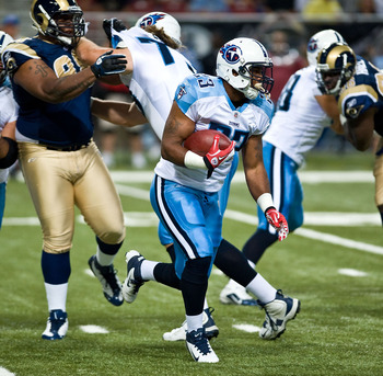 ST. LOUIS, MO - AUGUST 20:  Jamie Harper #23 of the Tennessee Titans carries the ball for yardage against the St. Louis Rams at the Edward Jones Dome on August 20, 2011 in St. Louis, Missouri.  (Photo by Ed Szczepanski/Getty Images)