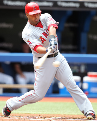 TORONTO, CANADA - AUGUST 14:  Vernon Wells #10 of the Los Angeles Angels of Anaheim bats in a MLB game against the Toronto Blue Jays on August 14, 2011 at the Rogers Centre in Toronto, Canada. (Photo by Claus Andersen/Getty Images)
