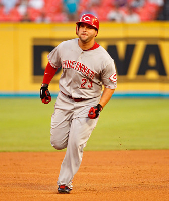 MIAMI GARDENS, FL - AUGUST 23:  Yonder Alonso #23 of the Cincinnati Reds rounds second after hitting a solo home run during a game against the Florida Marlins at Sun Life Stadium on August 23, 2011 in Miami Gardens, Florida.  (Photo by Mike Ehrmann/Getty
