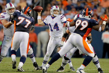 DENVER, CO - AUGUST 20:  Quarterback Ryan Fitzpatrick #14 of the Buffalo Bills throws a pass against the Denver Broncos during the second quarter at Sports Authority Field at Mile High on August 20, 2011 in Denver, Colorado. (Photo by Justin Edmonds/Getty