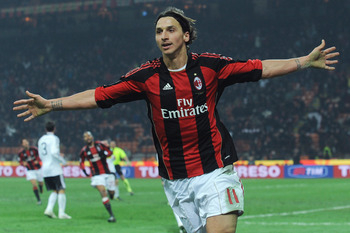 MILAN, ITALY - JANUARY 23:  Zlatan Ibrahimovic of AC Milan celebrates scoring his team's second goal during the Serie A match between AC Milan and AC Cesena at Stadio Giuseppe Meazza on January 23, 2011 in Milan, Italy.  (Photo by Valerio Pennicino/Getty
