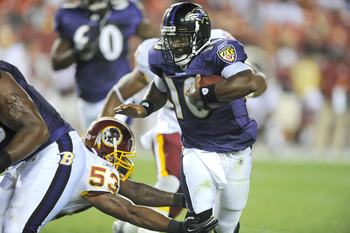 LANDOVER, MD - AUGUST 21: Troy Smith #10 of the Baltimore Ravens breaks a tackle of Perry Riley #53 of the Washington Redskins during the preseason game at FedExField on August 21, 2010 in Landover, Maryland.  (Photo by Greg Fiume/Getty Images)
