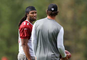 FLAGSTAFF, AZ - JULY 30:  Wide receiver Larry Fitzgerald #11 of the Arizona Cardinals talks with quarterback Kevin Kolb #4 during the team training camp at Northern Arizona University on July 30, 2011 in Flagstaff, Arizona.  (Photo by Christian Petersen/G