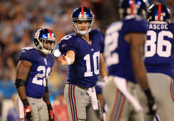 CHARLOTTE, NC - AUGUST 13:  Eli Manning #10 of the New York Giants calls a play against the Carolina Panthers during their preseason game at Bank of America Stadium on August 13, 2011 in Charlotte, North Carolina.  (Photo by Streeter Lecka/Getty Images)