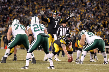 PITTSBURGH, PA - JANUARY 23:  Ben Roethlisberger #7 of the Pittsburgh Steelerscalls signals at the line of scrimmage behind center Doug Legursky #64 against the New York Jets during the 2011 AFC Championship game at Heinz Field on January 23, 2011 in Pitt