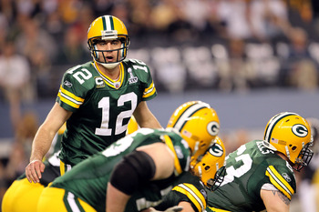 ARLINGTON, TX - FEBRUARY 06:  Quarterback Aaron Rodgers #12 of the Green Bay Packers looks down the line of scrimmage against the Pittsburgh Steelers during Super Bowl XLV at Cowboys Stadium on February 6, 2011 in Arlington, Texas. The Packers won 31-25.