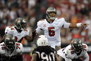 GLENDALE, AZ - OCTOBER 31:  Josh Freeman #5  and Carnell Williams #24 of the Tampa Bay Buccaneers react at the line of scrimmage against the Arizona Cardinals at University of Phoenix Stadium on October 31, 2010 in Glendale, Arizona.  (Photo by Harry How/