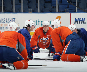 UNIONDALE, NY - JULY 13:  Long Island native Stephen Alonge #64 of the New York Islanders helps lead stretching exercises at the prospects evaluation camp at Nassau Veterans Memorial Coliseum on July 13, 2011 in Uniondale, New York.  (Photo by Bruce Benne
