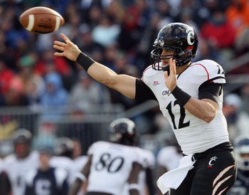 EAST HARTFORD, CT - NOVEMBER 27:  Zach Collaros #12 of the Cincinnati Bearcats passes the ball i n the first half against the Connecticut Huskies on November 27, 2010 at Rentschler Field in East Hartford, Connecticut.  (Photo by Elsa/Getty Images)