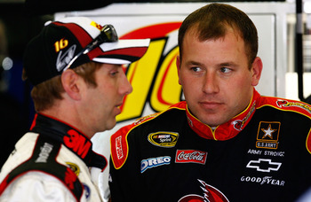 ATLANTA - MARCH 05: Ryan Newman (R), driver of the #39 Tornados Chevrolet, talks with Greg Biffle (L), driver of the U.S. Cencus Ford, in the garage during practice for the NASCAR Sprint Cup Series Kobalt Tools 500 at Atlanta Motor Speedway on March 5, 20