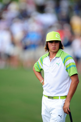 JOHNS CREEK, GA - AUGUST 13:  Rickie Fowler waits on the first green during the third round of the 93rd PGA Championship at the Atlanta Athletic Club on August 13, 2011 in Johns Creek, Georgia.  (Photo by Stuart Franklin/Getty Images)