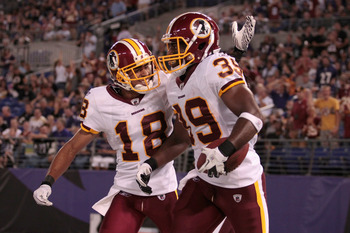 BALTIMORE, MD - AUGUST 25: Terrence Austin #18 of the Washington Redskins congratulates Tim Hightower #39 after Hightower scored against the Baltimore Ravens during the first half of a preaseason game at M&T Bank Stadium on August 25, 2011 in Baltimore, M
