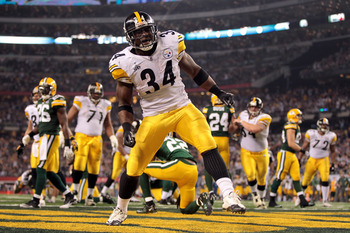 ARLINGTON, TX - FEBRUARY 06:  Rashard Mendenhall #34 of the Pittsburgh Steelers celebrates after he scored an 8-yard rushing touchdown against  the Green Bay Packers in the second half during Super Bowl XLV at Cowboys Stadium on February 6, 2011 in Arling